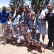 Coach Jimnah Kimani (far right) with the AKA Mombasa Open Boys' Basketball team