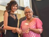 First Lady Margaret Kenyatta presents the female student of the year award to Ruhi Kamal Manek
