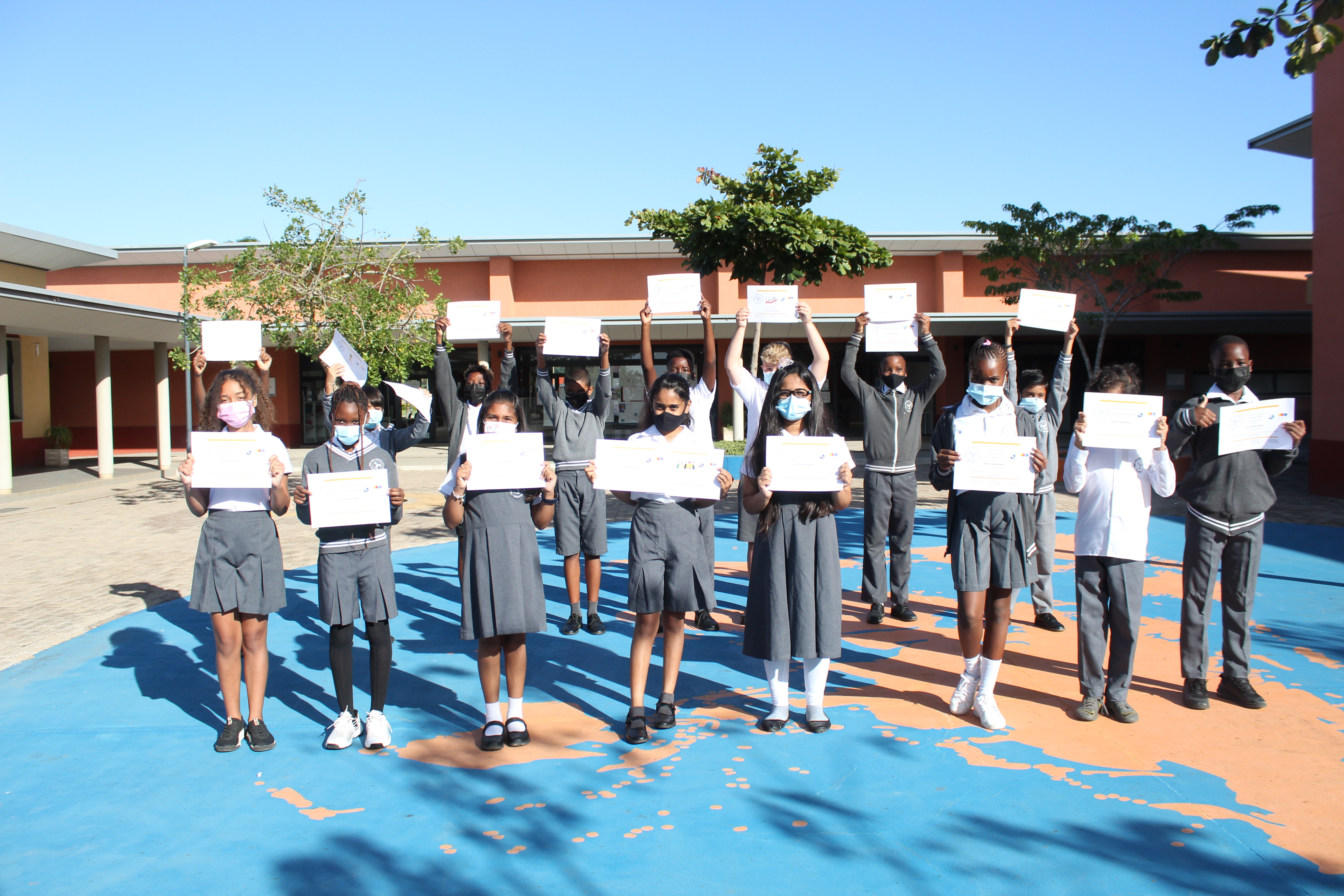 Grade 5 students with their certificates