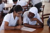 Students from Aga Khan Academy Mombasa and Mbaraki Girls High School work collaboratively on an activity